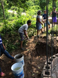 Community members aid in the water tank construction by helping us lay blocks.