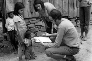 Surveillance Team Member Questions a Family about a Potential Smallpox Case,Brazil. Courtesy of the World Health Organization